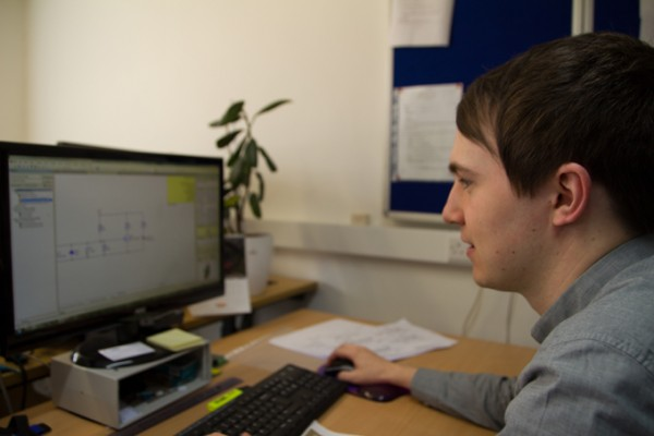 Tom Edwards at GSPK Design LTD working on a circuit board